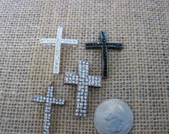 4 assorted rhinestone crosses