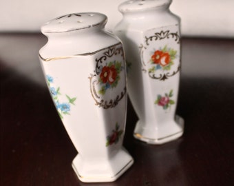 Vintage hand painted ceramic salt and pepper shakers.