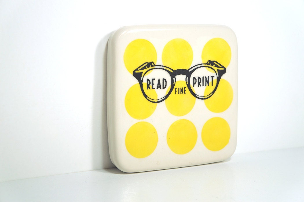 "tile with ""read fine print"" sign on yellow polkadots, made to order."