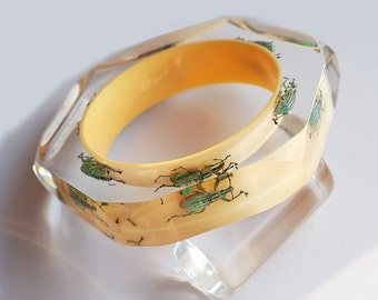Soft yellow lucite bracelet with real beetles