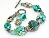 RESERVED - Aqua Green Lampwork Bracelet, Flowers, Floral, Swarovski Crystals, Silver