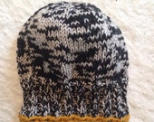 Black and white baby beanie with mustard trim