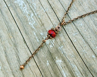 Antiqued Copper Wire Wrapped Necklace with deep red Czech Picasso glass rondelle bead and chain dangle