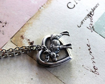 Loves moose. locket necklace.silver ox color jewelry