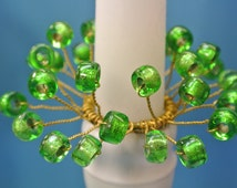 Pair of unique handmade bobeches of vintage handblown foiled grass green glass beads and brass wire