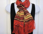 Vintage Oblong 52 by 11.5 inch scarf plus 3.5 inches of fringe, Red, black, tan, wine stripe with scroll design, Bonus magnetic back brooch