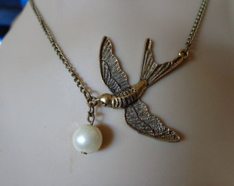 Brass Bird with Pearl Necklace