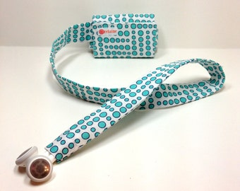 Turquoise dots TuneTube.  Earbud cord organizer for iPhone or iPod.  Cord keeper.  Earbud holder.  Earbud case.