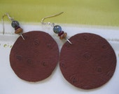 Leather Round Disk Earrings-Tan Ostrich Print Leather backed with Grey Ultrasuede, topped with three glass beads. It has sterling earwires
