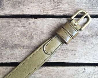 vintage c. 1980s Coach olive green cowhide belt w. solid brass buckle 28