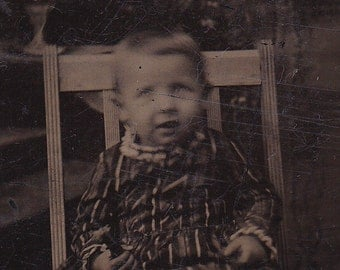 1800s Antique tintype portrait of a child, ferrotype photograph.