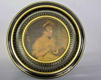Large round tin featuring a sweet girl