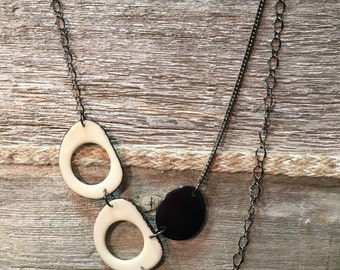 Ivory and black asymmetrical necklace