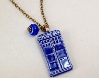 The Doctor's Police Box Necklace in Brass (N-212)
