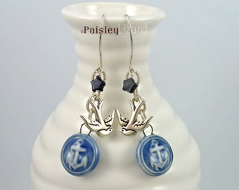 Blue Nautical earrings with sapphire blue porcelain anchor charms, goldstone stars, and swallow dangles on sterling silver wire