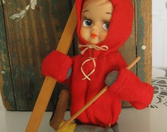 Vintage Christmas Doll Figure, Skier With Broken Leg, Red Hoody. Wrapped Leg, Holding Ski