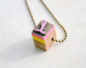 Vintage wooden typographic necklace. Antique bronze chain. Letter L yellow pink wood