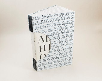 Blank Hand-bound Journal, Notebook or Guestbook with a Writing Theme