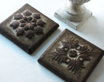 two cement floral pattern tiles