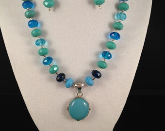 Ocean blues pendant style necklace with matching earrings 2 pc set.