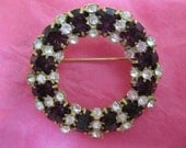 Vintage costume jewelry  /  purple and clear rhinestone brooch