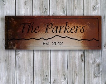 Personalized Family Name Sign on Rusted Metal with Mountain Silhouette - MADE TO ORDER