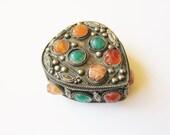 Gemstone trinket box: Beautiful handmade kuchi-style engraved silver trinket box with gemstones, coloured glass and blue velvet lining