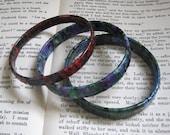 "Red bangle 1/4"" and Blue Green bangle 1/2"""