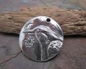 Bird of Hope Coin Pendant from Green Girl Studios