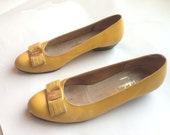 Bows At The Toes Shoe Sale .Adorable yet Scuffy canary yellow leather shoes .sensible short heels .Ferragamo .7 or 6.5 made in Italy