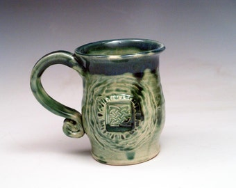 Carved Green Stoneware Mug with Celtic Knot