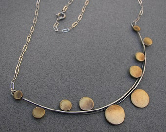 Architectural necklace: sterling-silver, modern, architectural necklace with cascading brass discs