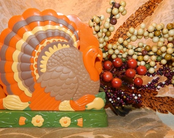 Celebrate Thanksgiving with a Colorful Hard Plastic Napkin Holder shaped like a Turkey on both sides