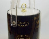 Vintage Barware Ice Bucket has Advertisements for Harry's Bar, Casino Monte Carlo, George V, Orient Express, Maxim's, and Captain's Cabin