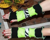 Hand crafted arm warmers using repurposed recycled sweaters