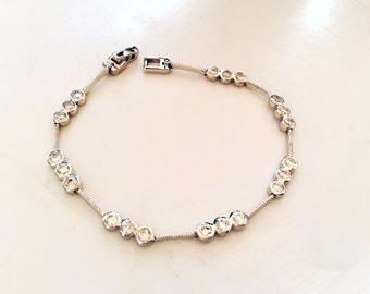 Silver rhinestones bracelet silver color with spaced rhinestones elegant piece