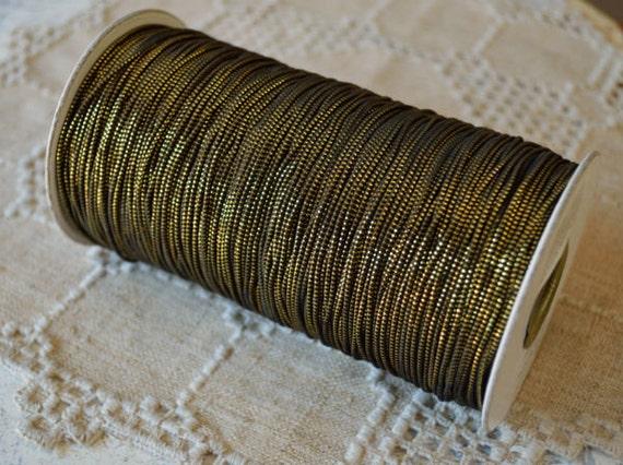 stretch bracelet cord elastic black with gold 1mm 300 yard