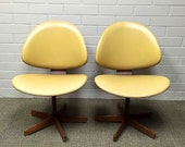 Pair of Mid Century Modern Kodawood Yellow Vinyl Swivel Chairs