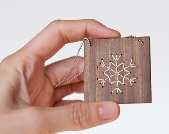 Snowflake · Pendant of square wooden with embroidered snowflake silhouette  · white color . Wooden Necklace Eco Friendly. Ball chain