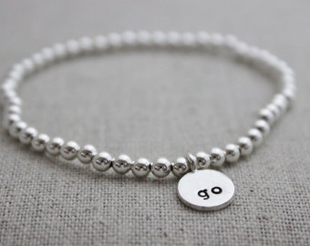 sterling silver bead stacking stretch bracelets, stamped initial bracelet, hill tribe silver pendant, stamped initial tag bracelet