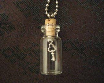 Steampunk key-in-a-bottle necklace