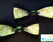 Black, green, and white hair bows with bats. Portion of sale goes to charity.