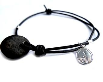 Black sea pebble bracelet, sterling silver 925 pendant on black leather cord