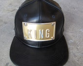ROJAS KING metal and leatherette snapbacks hat leather ish snapback hats cap gold metals