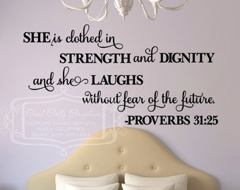 She is clothed in strength and dignity and she laughs without fear of the future.  -Proverbs 31:25  Vinyl wall decal Scripture Verse