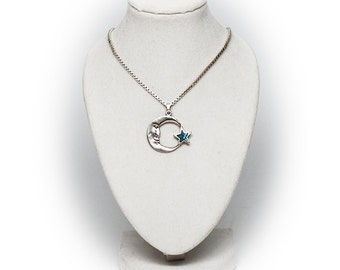 Sterling Silver Man in the Moon Pendant accented with Turquoise Star and 15 Inch Chain
