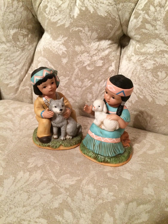 home interior native american children figurines holding a