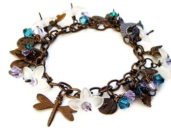 OOAK Secret Garden CHARM BRACELET, in Patina, with Swarovski Crystal Beads in Blue and Violet, Lucite Flowers and Patina Charms