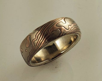 14k white gold 14k red gold with sterling silver random pattern etched mokume gane wedding band