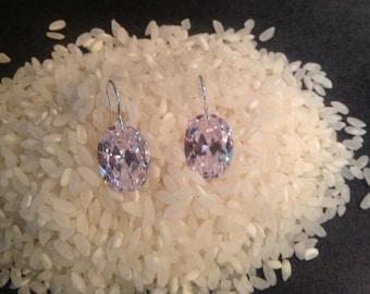 Dazzling , dangling diamond- like oval CZ earrings.
